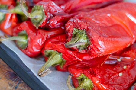 Roasted red peppers for winter preparation in the kitchen.