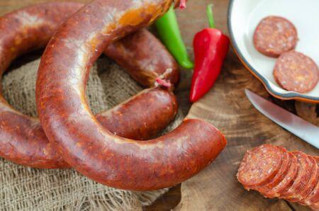 Turkish sausage sucuk on a cutting board,top view, Фото со стока
