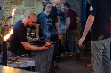 Eskisehir,TURKEY-September 27,2019: Odunpazarı 7th international glass festival.Artist Elliot Walker (England) is shaping his work.
