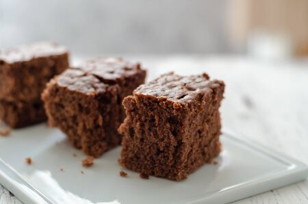 Slices of chocolate cake on the white plate.