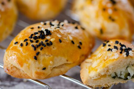 Homemade cheesy pastry on the table,close up. Zdjęcie Seryjne