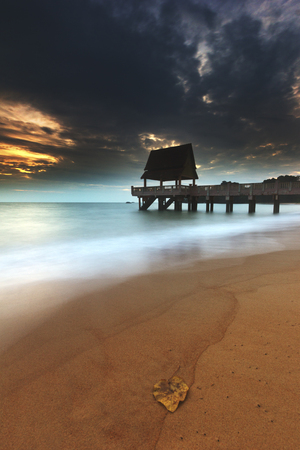 seascapes: A jetty was build at the beach which is extended to the sea. Capture in portrait format