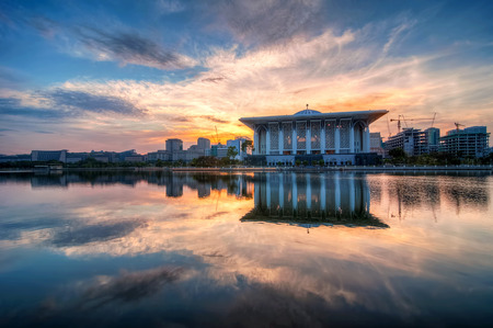 islamic scenery: Beautiful mosque with reflection in Putrajaya, Malaysia by the lakeside during sunrise  Editorial