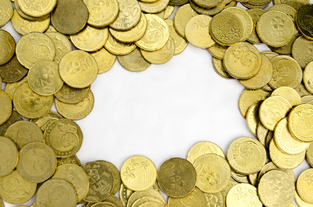 encash: image of gold coins with white background