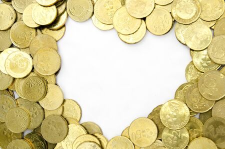 encash: image of coins with white heart shape background Stock Photo
