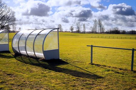 Empty sports ground in early spring after the rain photo