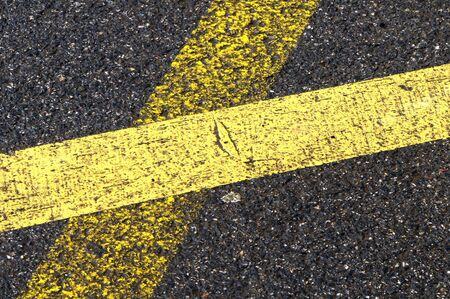 marking': Close-up of old and new lanes on the road