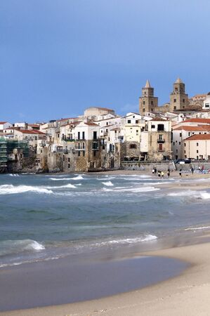 Beach, sea and old Sicilian town, Cefalu photo