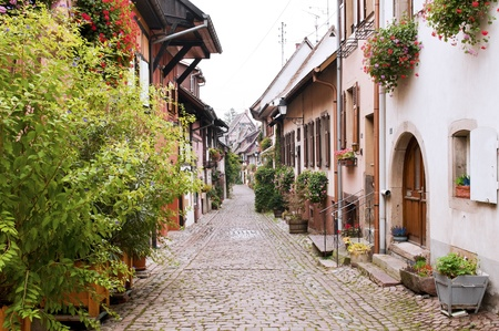 alsace: Street Gothic town in France, Eguisheim, Alsace Stock Photo