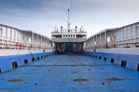 The ferry at the port with empty deck photo