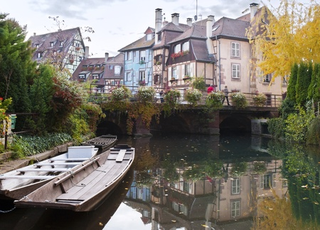 Old houses and the river in the town of Colmar photo