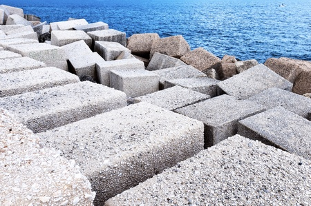 breakwaters: Big cubic concrete breakwaters on the coast