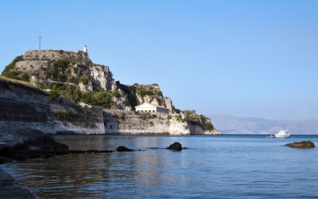 Lighthouse in Kerkyra town, the coast of Corfu photo