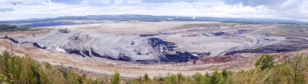 Powerful machines working in the open coal quarry  photo