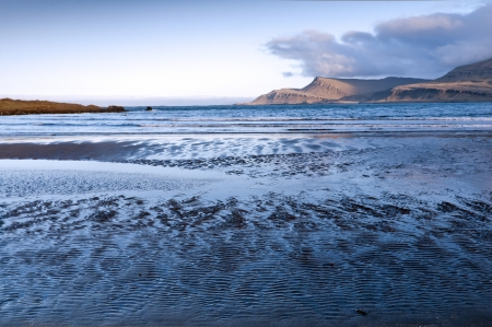 The outflow of sea in the bay, east coast, Iceland photo