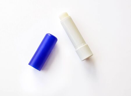 Lip balm on a white background with shadow photo