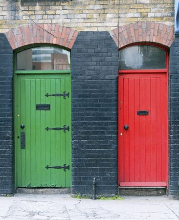 Green and red old exterior doors, Ireland photo