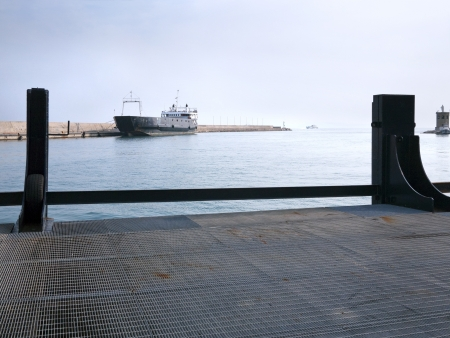 A ferry boat in the empty port. photo