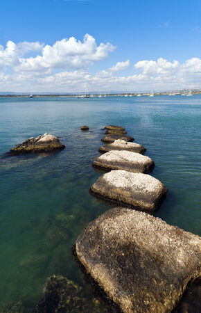 breakwaters: The summer landscape with breakwaters and the blue sea