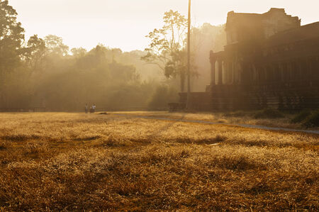 angor: An outer wall of temple Angkor Wat and surrounding of the temple in the morning, Cambodia Stock Photo