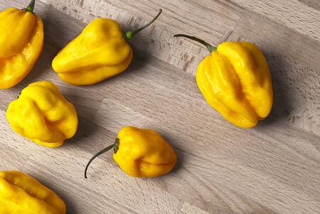 habanero: Several yellow habanero chilies.