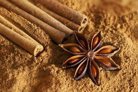christmas ground: Cinnamon sticks, ground cinnamon and star anise - Christmas spices Stock Photo