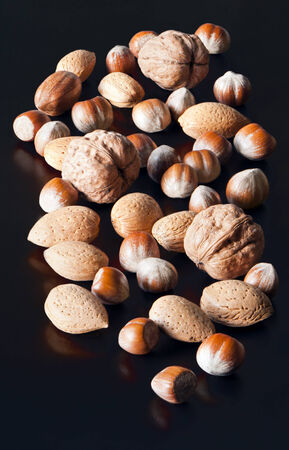 ingedient: Mixed nuts in shells. Hazelnuts, walnuts, almonds, pecans.