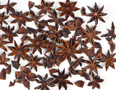 badiane: Star anise, star aniseed, or Chinese star anise on the white background Stock Photo