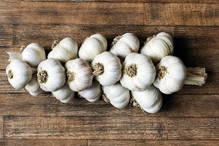 Bunch of garlic on a wooden board