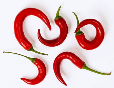 several: Several chili peppers on the white background Stock Photo