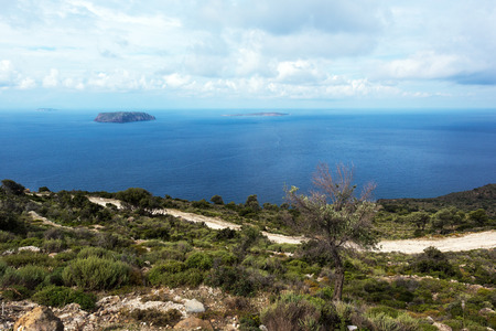 stone volcanic stones: The landscape with the sea and a volcanic Greek island. View from Nisyros,  Greece Stock Photo