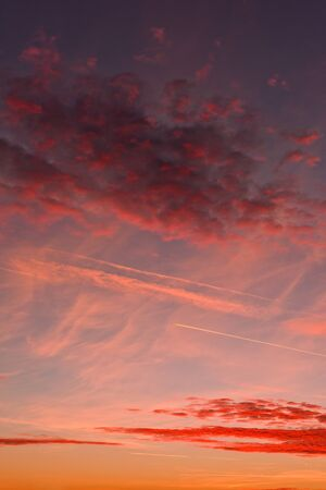Afterglow evening sunset and vapor trails (condensation trails)