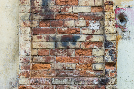 An old shabby colored brick wall, background, texture 免版税图像