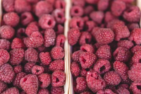 Raspberries on a farm market in the city. Selective focus.
