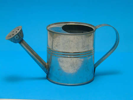 watering can in blue background Stock Photo
