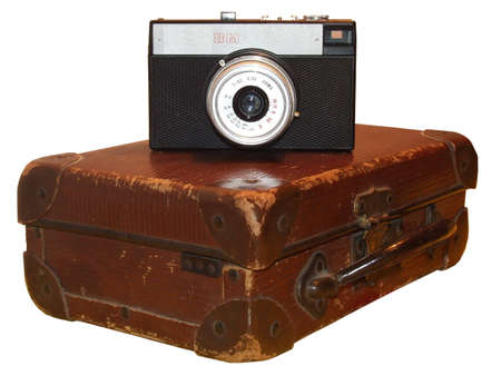 old-fashioned photocamera and leather case isolated on white.