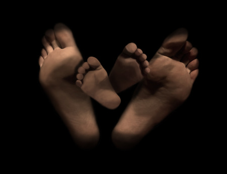 Foot of a father and child on black backgraund, Creative concept for Happy Fathers Day.