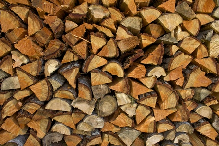 woodpile: Pile of split fire wood of various types of wood. Stock Photo