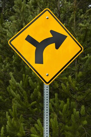 Sign indicating right road must be taken Stock Photo - 12359455