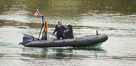 Police boat patrolling in harbour Editorial