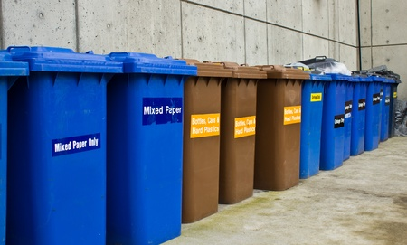 Row of Recycling and Garbage Cans lined up