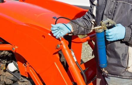 greasing: Hard at work maintaining piston with greasing gun
