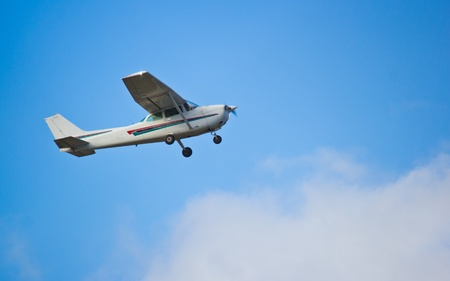 cessna: One engine small passanger aircraft taking off at airport