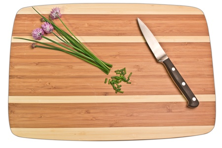 Chives and herbs on top of cutting board photo