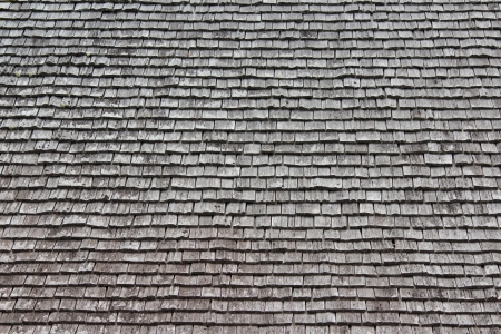cedar shakes: Rows of shakes ordered on a house roof
