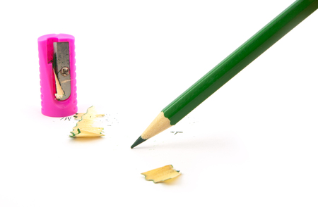 green pencil with sharpener on a white background photo