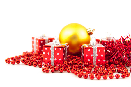 Red Christmas toys on a white background photo