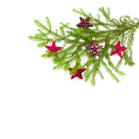 Xmas tree with toys on a white background photo