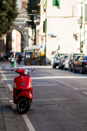 red moped in the street in Italy photo