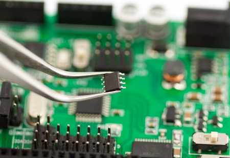 Assembling a circuit board close up Stock Photo
